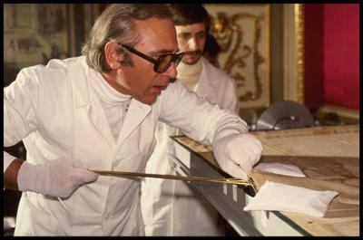 Professor Giovanni Riggi di Numana inserting a special 'bridge' between the Shroud and the Holland cloth to separate the cloths and provide access for his vacuum and endoscope experiments in 1978