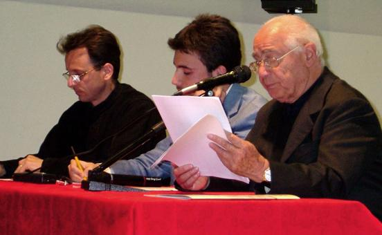 Fr. George Militaru and Michele Paolini at the conference in Perugia as Don Augusto Bonelli reads Kim Dreisbach's paper