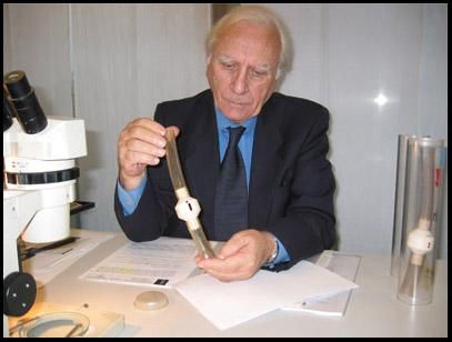 Professor Giovanni Riggi di Numana in a recent photograph holding a filter containing dusts aspired from the Shroud in 1978