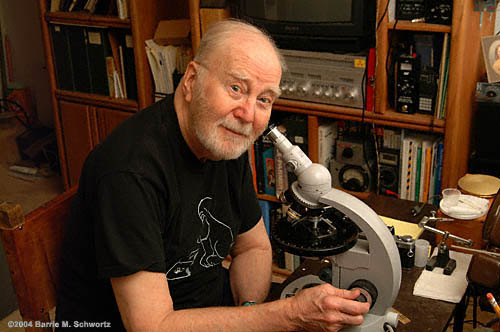 Ray Rogers at his Petrographic Microscope   ©2004 Barrie Schwortz